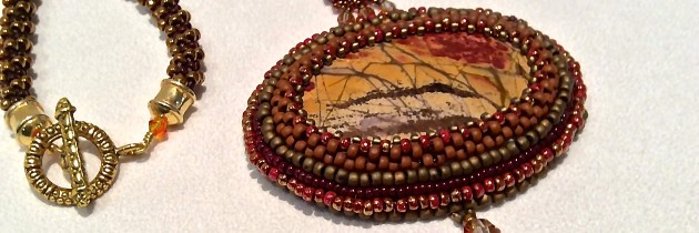 Red Jasper Creek Embroidered Stone